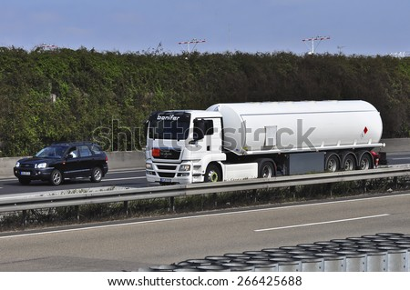 FRANKFURT,GERMANY-MARCH 28:NAN oil truck on the highway on March 28,2015 in Frankfurt,Germany.MAN SE, formerly MAN AG, is a German mechanical engineering company and parent company of the MAN Group.
