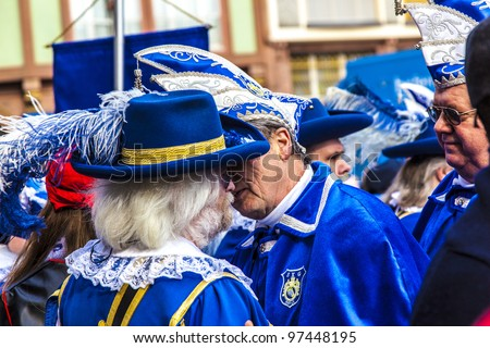 FRANKFURT, GERMANY - MARCH 5: The colorful Carnival  Parade moves through the city on March 5, 2011 in Frankfurt, Germany. They conquest the town hall and get the key for one day from the mayor.