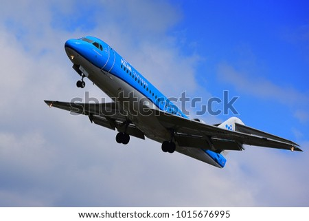 FRANKFURT,GERMANY-MAY 09,2017: KLM Royal Dutch Airlines Fokker 70 lands at Frankfurt airport.