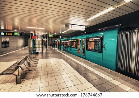 FRANKFURT, GERMANY - OCT 29: Subway train ready to leave the station on October 29th, 2013 in Frankfurt. With 181,000 passengers per day, Hauptwache is the third busiest transit station in Frankfurt #176744867