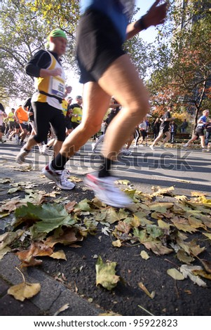 FRANKFURT, GERMANY - OCT 31: Unidentified runners in the Frankfurt Marathon on October 31, 2010 in Frankfurt, Germany. The race, currently sponsored by Commerzbank, is Germany's oldest city marathon.