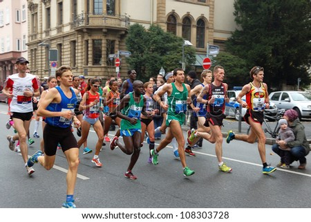 FRANKFURT, GERMANY - OCTOBER 30: Group of runners runs the BMW Frankfurt Marathon, October 30, 2011 in Frankfurt, Germany.