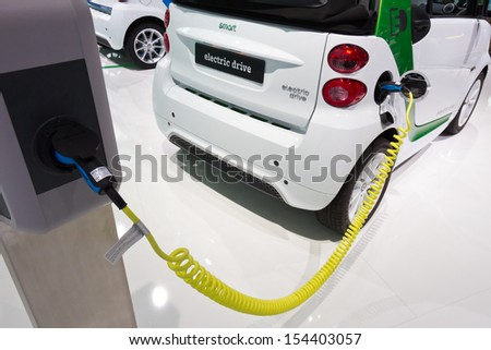 FRANKFURT, GERMANY - SEP 13: Charging a Smart Electric Drive at IAA motor show on Sep 13, 2013 in Frankfurt. More than 1.000 exhibitors from 35 countries are present at the world\'s largest motor show.