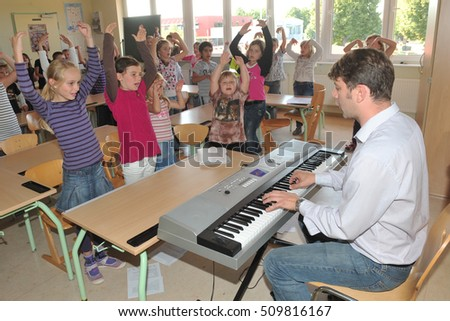 Frankfurt, Germany - September 6, 2010- Early musical education in german school #509816167