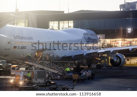 FRANKFURT, GERMANY - SEPTEMBER 20: Lufthansa Flight at the gate for morning flight on September 20, 2012 in Frankfurt, Germany. New Terminal A is under construction for airport enlargement.