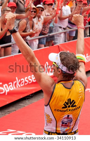 FRANKFURT - JULY 5. Ironman Germany 2009. Timo Bracht winner is cheering at the german crowd after victory. July 5, 2009 in Frankfurt, Germany.