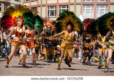 FRANKFURT - JUNE 26. Bolivians performing a war dance at the Parade der Kulturen. June 26, 2010 in Frankfurt, Germany.