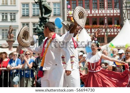 FRANKFURT - JUNE 26: Colombians dance in traditional costumes at the Parade der Kulturen. June 26, 2010 in Frankfurt, Germany.