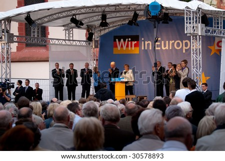 FRANKFURT - MAY 19 : Crowd listen as Angela Merkel delivers her speech for European General Elections May 19, 2009 in Frankfurt.