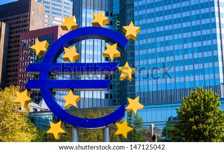 FRANKFURT - MAY 5: The Famous Big Euro Sign at the European Central Bank on May 5, 2013 in Frankfurt, Germany. The bank was established by the Treaty of Amsterdam in 1998.