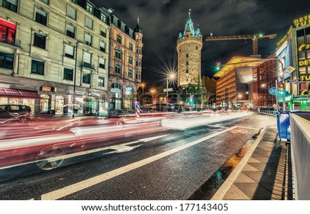 FRANKFURT - OCT 30, 2013: City lights at night with car light trails. Frankfurt is the largest financial centre in continental Europe and ranks among the world\'s leading financial centres.