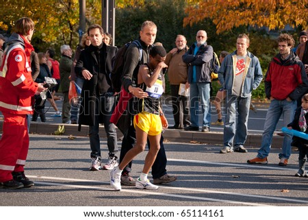 FRANKFURT - OCTOBER 31: Runner being attended by medics at Commerzbank Franfkurt Marathon 2010.  October, the 31st, 2010 in Frankfurt, Germany.
