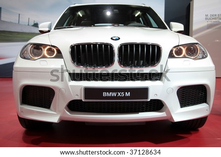 FRANKFURT - SEP 15: White BMW X6 M in front/frog view on 63rd IAA (Internationale Automobil Ausstellung) on September 15, 2009 in Frankfurt, Germany.