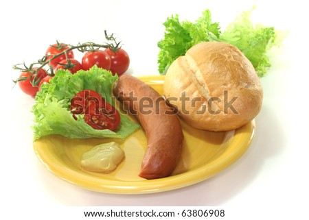Frankfurter sausages with bread and salad on a white background