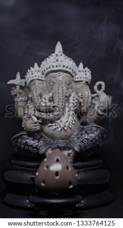 Frankincense point worshiping Ganesh