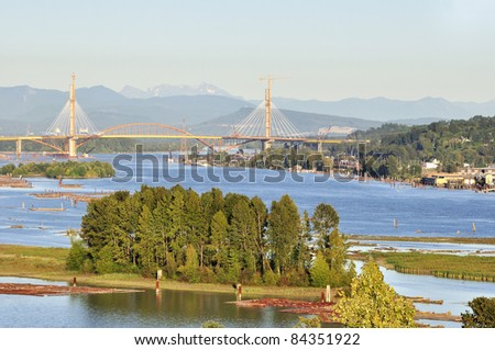 Fraser River with Trees on an Island and a Bridge under Construction