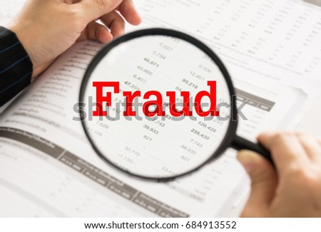 Fraud concept. financial statement, spreadsheet accounting and magnifying glass with business fraud investigation. #684913552