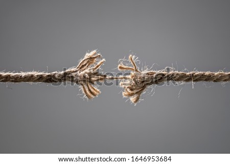 Frayed rope about to break concept for stress, problem, fragility or precarious business situation Stockfoto ©