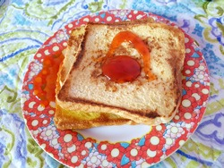 Freach toasts (also known as pan fried egg bread) with chilli sauce on top. Red flowery printed melamine plate just enhancing the looks and make this simple breakfast menu more appealing to eat.