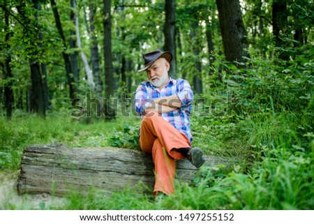 Freak healer. Folk magic. Mature man with beard in hat. Wise old man. Herbal remedies. Supernatural or superstitious. Person purported magical abilities. Magician in forest. Woodman magician concept.