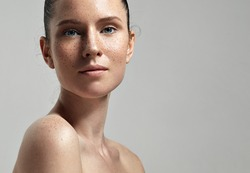 freckles woman's face portrait with healthy skin