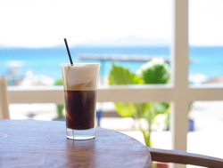Freddo Cappuccino with a Beach View in Kos Island - Holiday in Greece