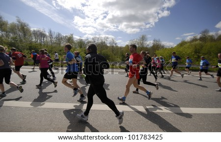 FREDERICIA, DENMARK - MAY 5: Closeup runners in the sun after 11,5 km in Little Belt Half Marathon run, Kystvejen in Fredericia, Denmark. May 5, 2012