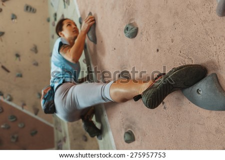 free climber young woman...