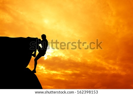 Free climbing man at sunset