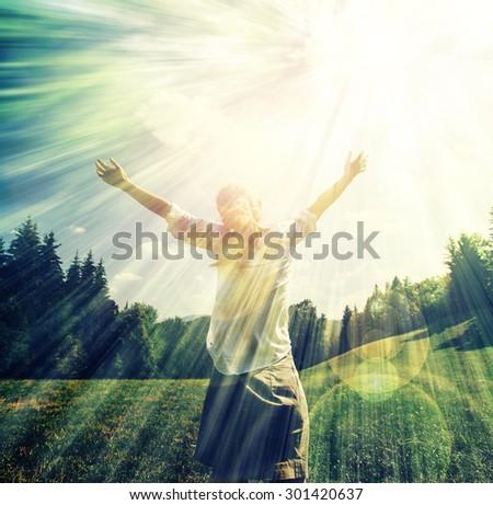 free happy woman enjoying beautiful landscape,summer vacation enjoyment . Beautiful woman facing the sun with open hands, sun greeting,