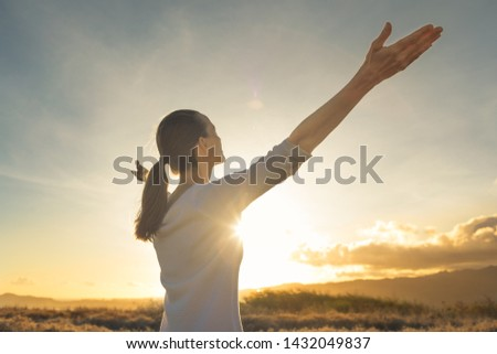 Free happy woman enjoying nature, freedom, happiness, and enjoyment concept.
