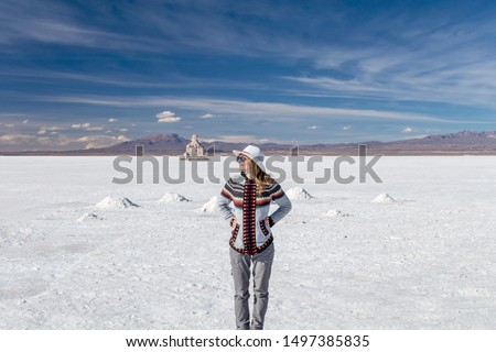 Free happy woman enjoying summer nature outdoors vocation. Freedom, travelling and enjoyment concept of beautiful Caucasian girl in her 20s. Image from Uyuni salt flat in Bolivia #1497385835