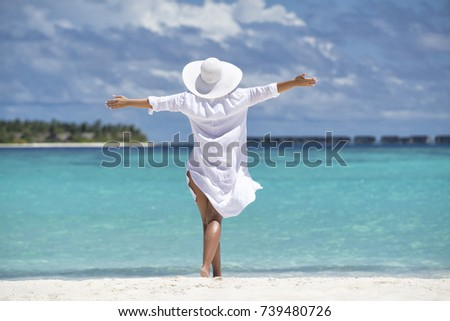 Free happy woman on beach enjoying nature. Natural beauty girl outdoor in freedom enjoyment concept.  #739480726