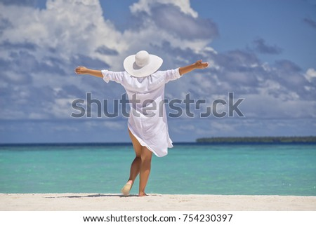 Free happy woman on beach enjoying nature. Natural beauty girl outdoor in freedom enjoyment concept.  #754230397