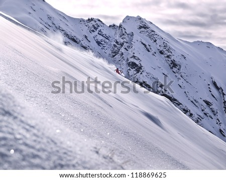 free ride skier with big mountain in backgroun