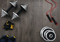 free space on the wooden floor surrounded fitness equipment