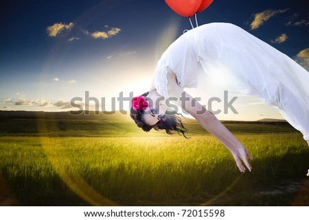 Free Spirited Woman Drifts With Two Balloons High In A Cloudy Sky Above A Beautiful Landscape Farmyard Field In An Image Representing Growth And Freedom