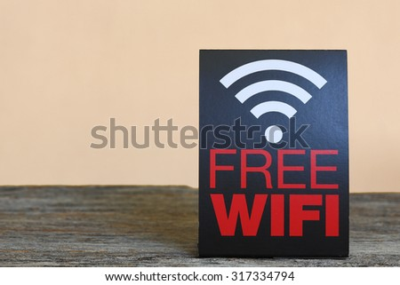 Free wifi area sign on wooden table