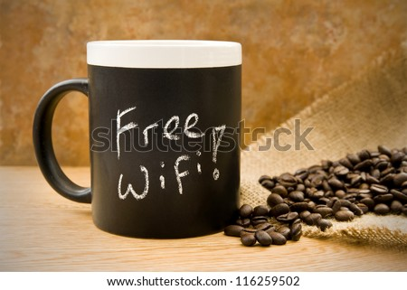 free wifi, coffee mug with coffee beans & hessian on counter