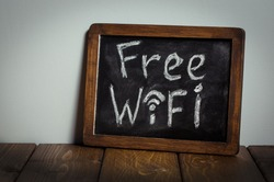 Free wifi sign. Wooden table.