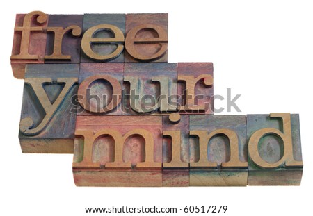 free your mind - relaxation or meditation concept - words in vintage wooden letterpress printing blocks, stained by color inks, isolated on white