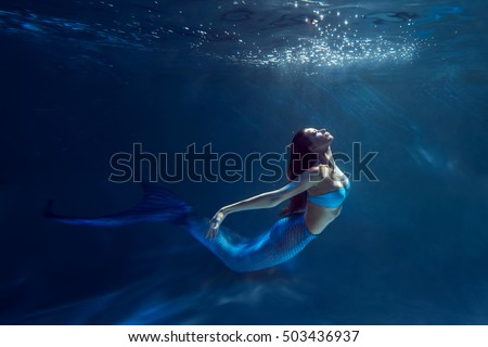 Stock Photo Freediver girl with mermaid tale