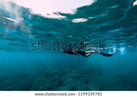 Freediver in wetsuit neoprene swim in the sea #1199339785