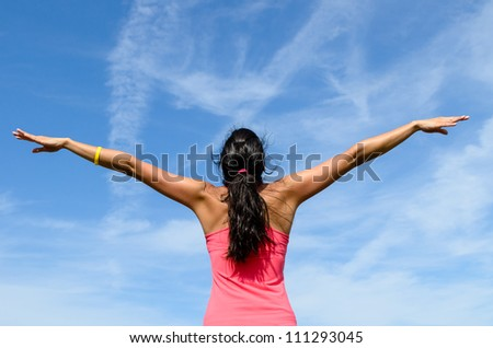 Freedom and happiness concept. Bliss summer day with joyful woman in flying posture. Copy space.