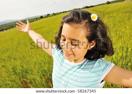 Freedom and happiness, girl in nature with opened arms and smile