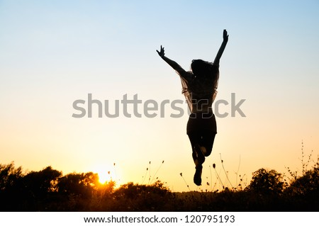 Freedom, beautiful girl jumping