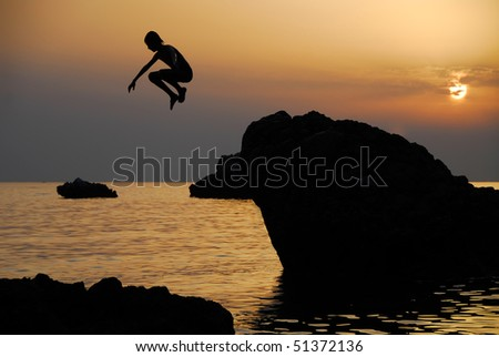 Freedom, child jumping on sunset over the see