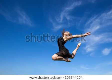 Freedom concept. Dancer jumping against blue sky (1)
