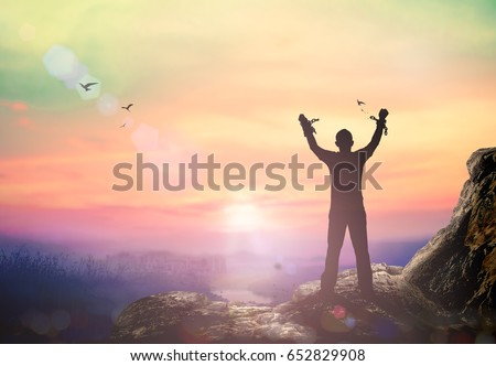 Freedom Concept Silhouette Human Hand Broken Chains Against Twilight Sky Background 652829908