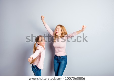 Freedom dreamy wish emotions people chill rest relax positivity win winner concept. Excited cheerful glad friendly impressed  cute kid and mum raising hands up casual jeans isolated on gray background #1007060806